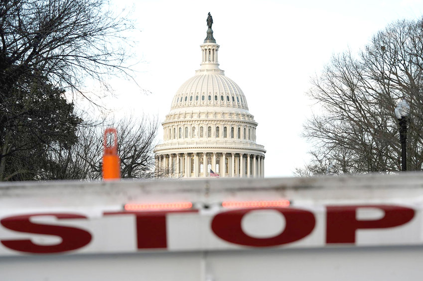 A SECURITY BARRICADE is placed in front of the U.S. Capitol on the first day of a partial federal government shutdown on Saturday.