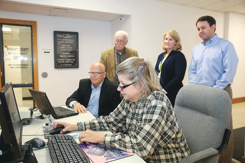 BRADLEY COUNTY ADMINISTRATOR of Elections Fran Green, center, watches her computer closely as the voting precincts close and tabulation results begin to roll in on election night at the Bradley County Election Commission during the November elections. Seated from left are Joe Reed, CPA and consultant to the Bradley County Election Commission and Green. Standing, from left, are Commissioners Dana Burgner, Cristy Schuch and Travis Henry.