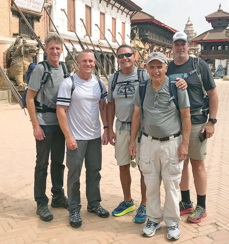 TIM HENDERSON, middle, stands with members a mission group on a street outside a temple in Katmandu, Nepal. The mission group was in-country visiting mountain villages, where Christian churches have been established. Also pictured are Jason Butte, Andrew Teeuwen, Dave Gregory and Marty Gregory.