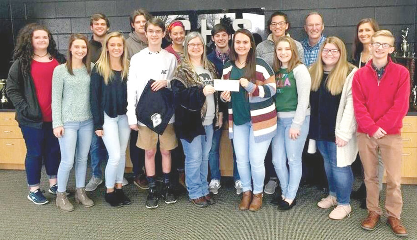 ENTREPRENEURSHIP STUDENTS from Bradley Central High School present a $1,000 donation to Denise O'Daniel, the mother of a BCHS student injured in a serious accident. The students earned the money from a business they started with the Junior Achievement Company Program.