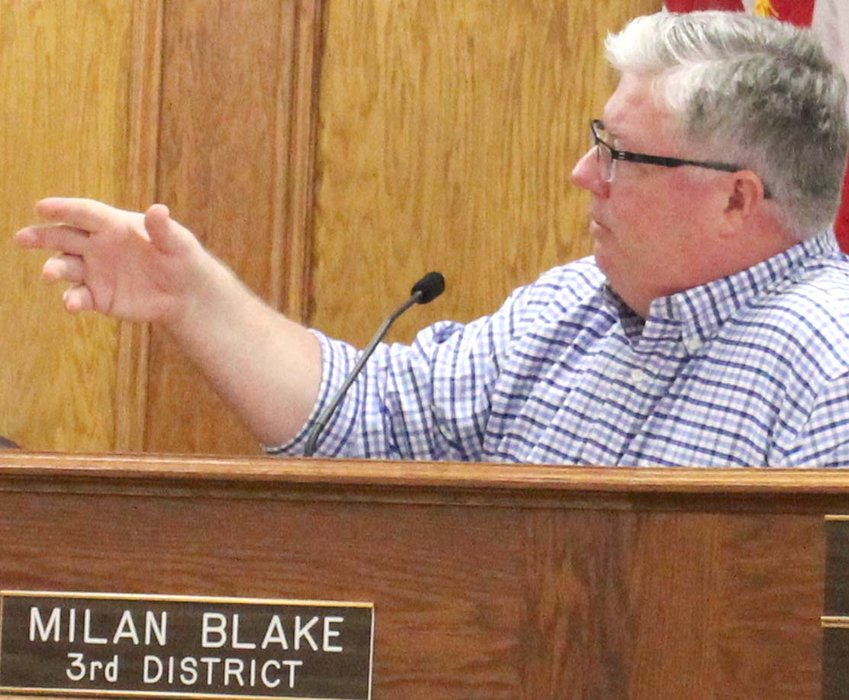 BRADLEY COUNTY Commissioner Milan Blake makes a point during Monday's discussion of infrastructure concerns at Chestnut Grove subdivision.