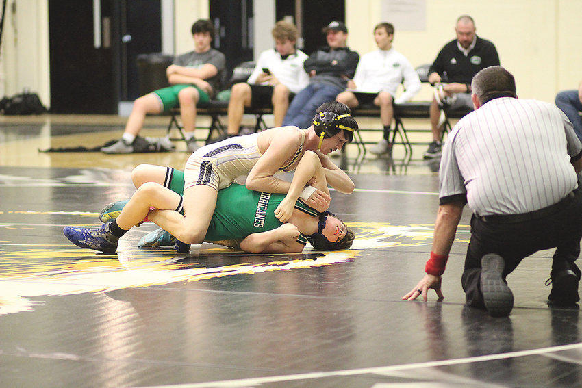 BRADLEY CENTRAL'S Glen O'Daniel goes for the pin in the first period against East Hamilton's Cale Boyd, in the 113-pound bout Tuesday, at Bradley.