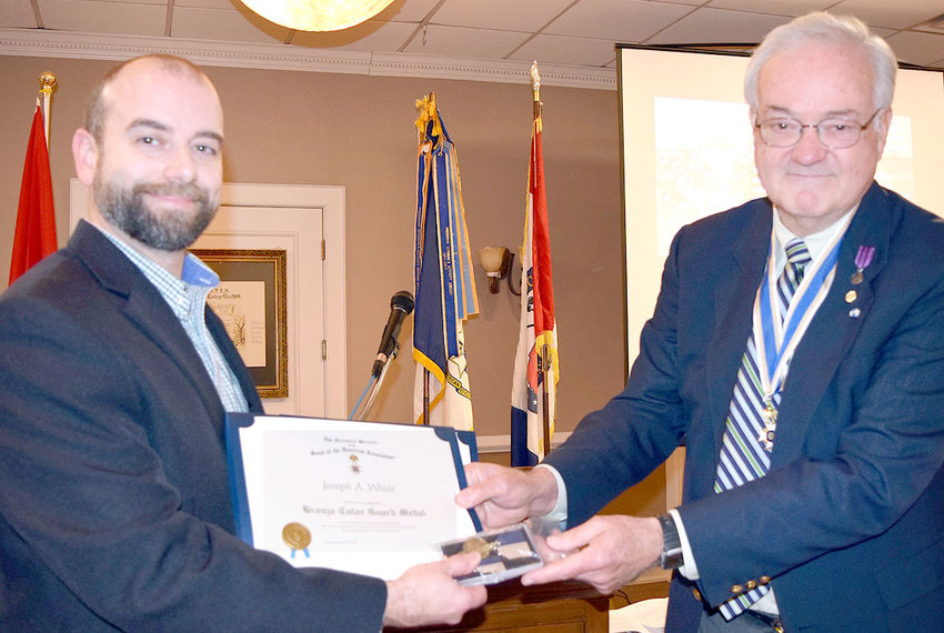 Joseph A. White, left, received the Bronze SAR Color Guard Medal and a supplemental certificate recognizing an American Revolution patriot ancestor from Col. Benjamin Cleveland Chapter President Dr. David Chaffin.