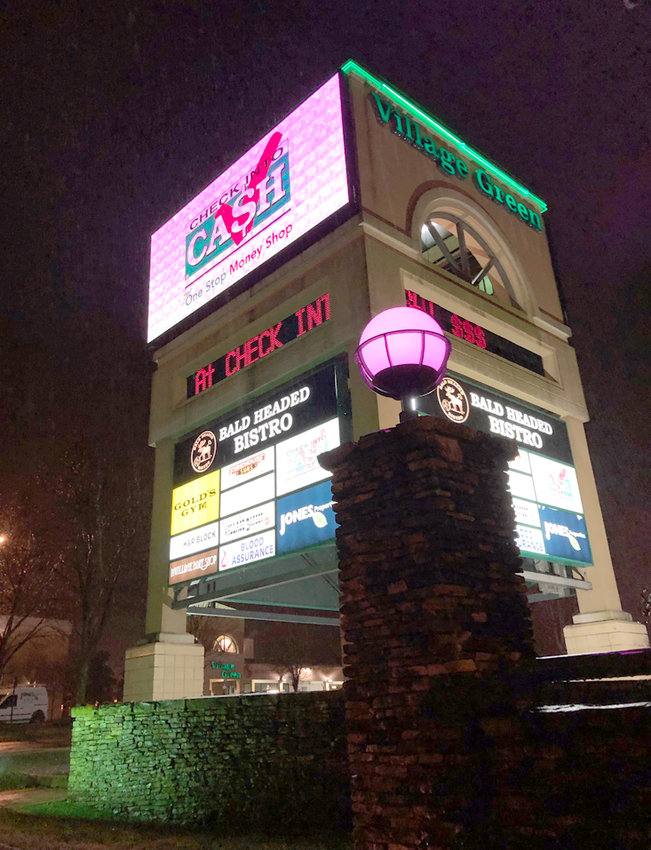 The Jones-A-Tron at the Village Green Town Center on Keith Street is illuminated pink this week in honor of the upcoming Pink Ball in Chattanooga.