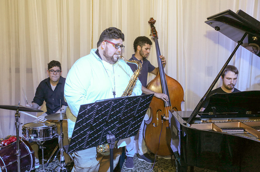 CURRENT AND FORMER LEE University students came together to provide some of the musical entertainment at Friday night's Friends of the Library Association's  Palooza event. From left are Robert Acevedo, Shaun Sneed, Japheth Varlack and Matthew Zalusky.