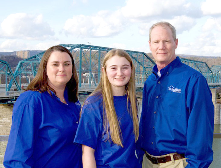 BRIAN WINTON, right, an Air Force veteran shown with family members, recently launched a new home care business for Southeast Tennessee, TruBlue.