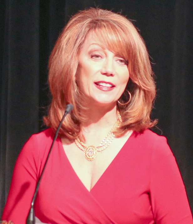 """INCOMING 2019 CHAIRMAN of the Board Kim Casteel delivers her """"2019: Promoting Our Community"""" presentation at the Chamber of Commerce Annual Meeting on Thursday night."""