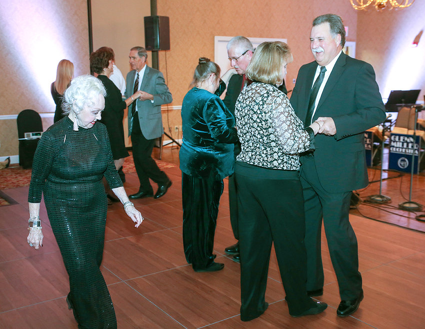 OLLIE HALL, left, observes attendees dancing before the Glenn Miller Orchestra event at the Cleveland Country Club. Ollie and Jack Hall provided 45 minutes of ballroom dancing instruction before the orchestra took the stage.