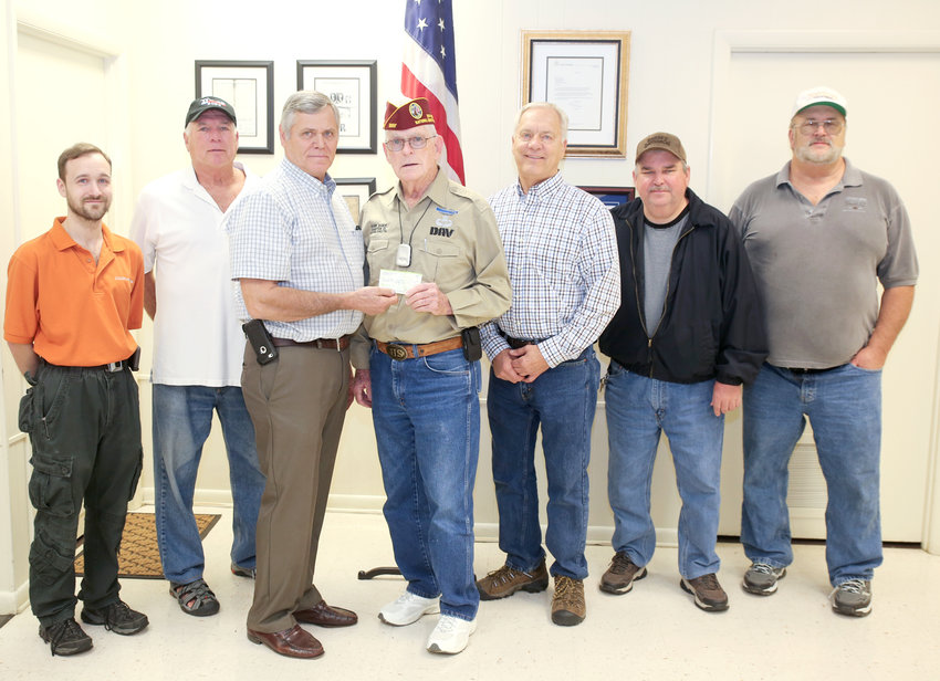 THE CLEVELAND CORVETTE Club, Tennessee, chose the Disabled American Veterans organization as recipient of their annual donation this year, and representatives from the group presented DAV Deputy National Chief of Staff Hank Baker, center, with a check donation on Wednesday at the Cleveland Daily Banner. From left are Eric Bramblett, Russ Robbins, Stoney Daniel, Baker, Gerald Ratcliff, Ernest Wilcox and Sam Ramsey.