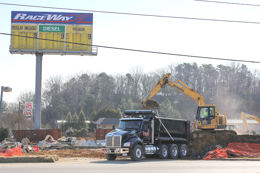 CONSTRUCTION WORKERS have been busy with preliminary site work for the new Racetrac fuel distribution center on 25th Street in Cleveland. The upscale prototype store will be located where the old Raceway convenience store has been for years, just to the west of the Cleveland Daily Banner (in the background).