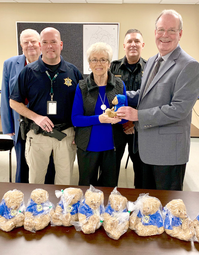 """VALLEY VIEW RURITAN CLUB members donate 10 """"Rudy Bears"""" to the Bradley County Sheriff's Office.  BCSO deputies will be handing out the bears to children they serve. From left are Ruritan Vice President Ralph Mason; Capt. Jon Collins; Ruritan President Barbara Mason; Lt. Tim Mason; and Sheriff Steve Lawson."""