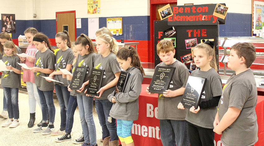BENTON ELEMENTARY Junior Beta Club members display awards they recently received in state and national competition. The presentation by approximately 30 club members to the Polk County Board of Education, described the many projects which led to the awards.