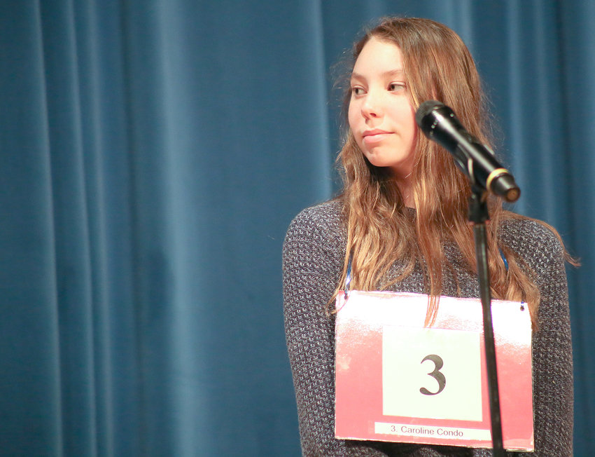 CAROLINE CONDO CHECKS with the judge to confirm that she's just won the 2019 Mildred Maupin Spelling Bee.