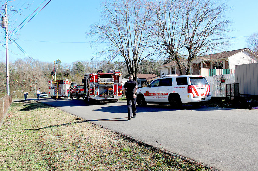 EMERGENCY vehicles line the street in front of a house where a fire started Wednesday afternoon. The resident of the home was injured and transported to Tennova-Cleveland. The burn victim reportedly sustained significant injuries and was later airlifted to a burn center in Atlanta.