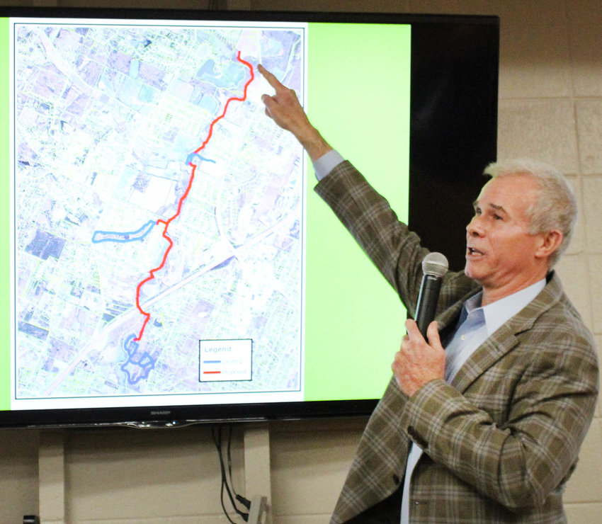 CAMERON FISHER, chairman of the Cleveland/Bradley County Greenway Committee, points to proposed future expansion of the Greenway during this week's work session of the Bradley County Commission.