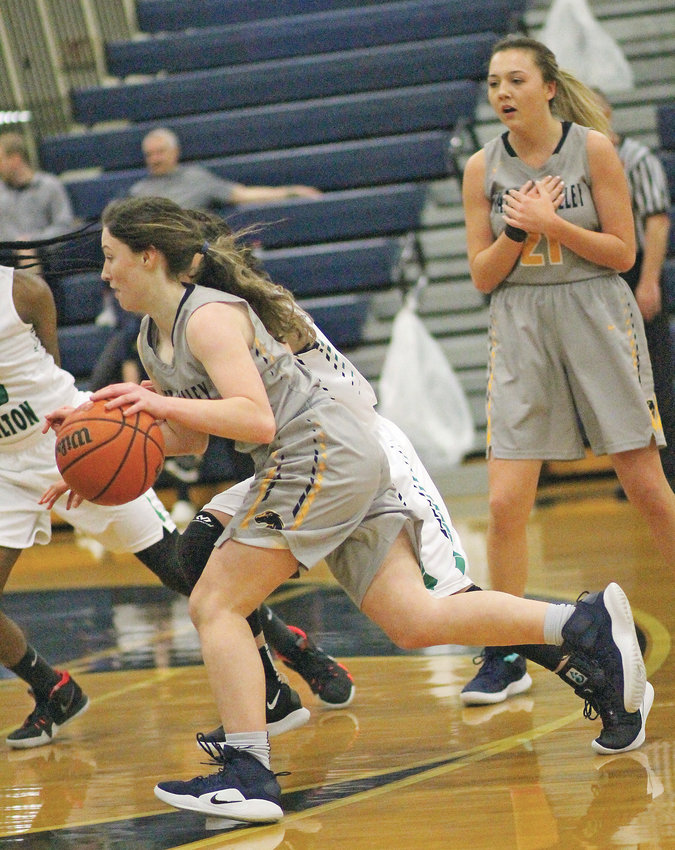 WALKER VALLEY freshman Cacyi Davis drives past an East Hamilton defender for two of her 11 points in District 5-AAA action Thursday evening in Soddy-Daisy.