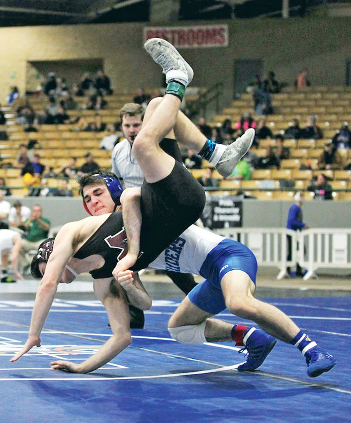 CLEVELAND BLUE RAIDERS 160-pound wrestler Zach Brezna, back, takes his opponent to the mat on the first day of the Tennessee State Wrestling Championships, in Franklin.