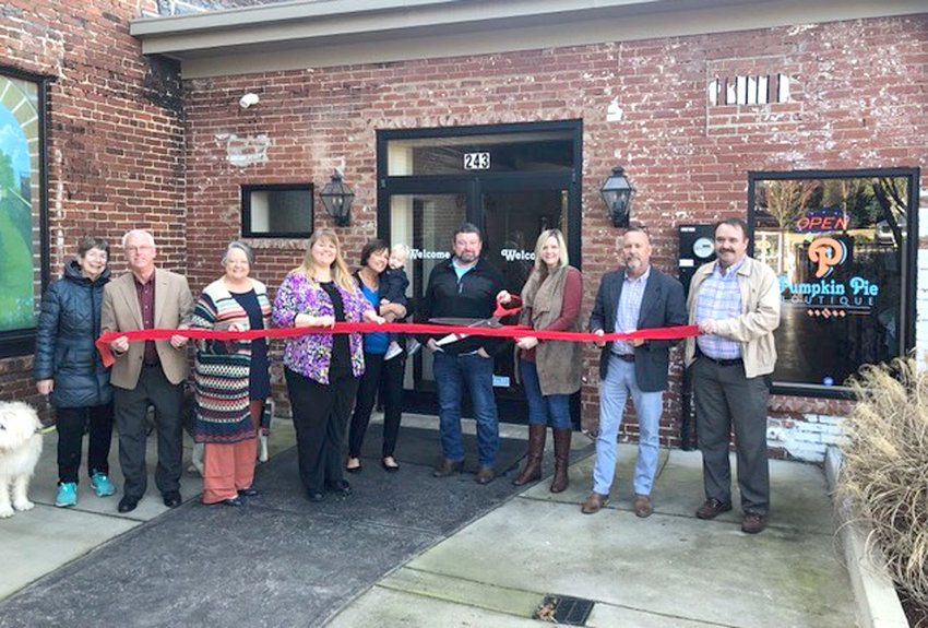 Mainstreet Cleveland members attending the ribbon cutting, including left to right, Sherry Brown, Ken Webb, Diane Webb, Evelyn Chadwick, Traci Hamilton and Beckham,  Robert Prueitt, owner Hollie Prueitt, Jim Metzger, and Barry Currin.