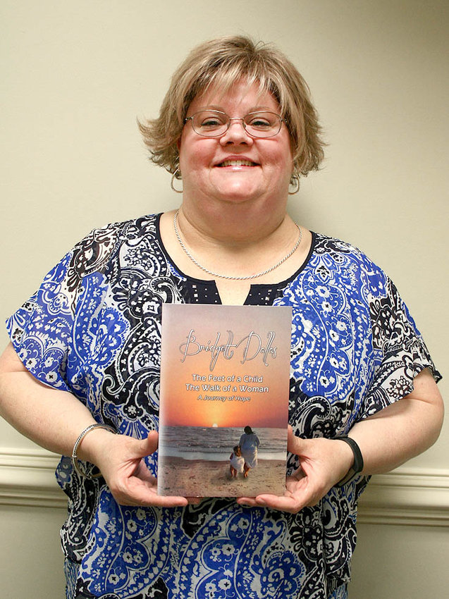 """BRIDGETT DALLAS,  a survivor of sexual abuse,  detailed her struggles and redemption through Christ in her new book, """"The Feet of a Child. The Walk of a Woman."""""""