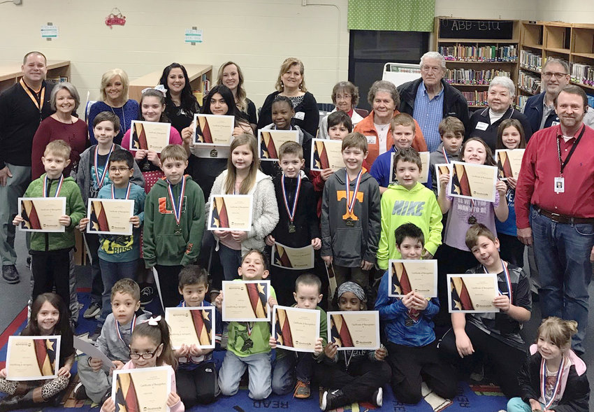 WOODMENLIFE INSURANCE COMPANY representatives presented more than 25 students at Oak Grove Elementary with certificates, medals and a special breakfast for their participation and improvement in the RTI program through their WOW Kid Program. The WOW Kid Program was developed in 2018 to recognize students in the RTI program  (Response to Intervention) in the areas of reading and mathematics, perfect attendance and  behavior. WoodmenLife rewards these students with a medal, window sticker and a certificate. Woodmen enjoys partnering with schools to recognize students and show support for all the hard work the students as well as teachers have accomplished.