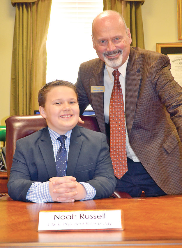 """Noah Russell, a fourth-grader at CSCC's BEST partner, Taylor Elementary, stepped in to fill Dr. Bill Seymour's shoes as """"President for the Day"""" at Cleveland State Community College on Wednesday. Russell was the winner of an essay contest where he discussed why he wanted to be president, and what he would do if chosen. Some of his items included requiring students to have at least eight hours of sleep a night so they would be well-rested, allowing the parents of students and employees to visit for three hours each day, as well as providing a spa for employees so they could have massages after a long, hard day. During his time at CSCC, he attended and ran the President's Cabinet meeting, shook a lot of hands and even gave a few pay raises. From left are Russell and Seymour."""