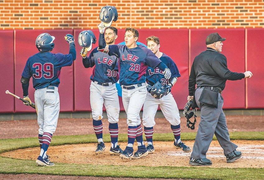 LEE FIRST BASEMAN Ryan Beamish (28) celebrates with teammates after hitting a three-run homer in the sixth inning against Carson-Newman Monday, at Lee.