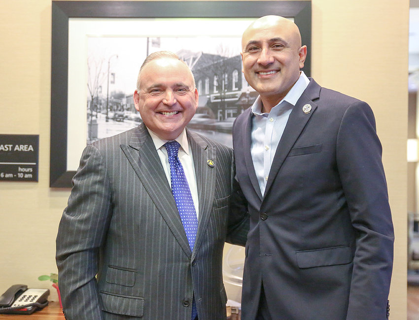 MITCH PATEL, president & CEO of Chattanooga-based Vision Hospitality Group Inc, spent the majority of his life in Cleveland since moving to the area when he was 10 years old to help manage the economy hotel his family acquired. Here, he poses for a photograph at a previous event with Cleveland Mayor Kevin Brooks.