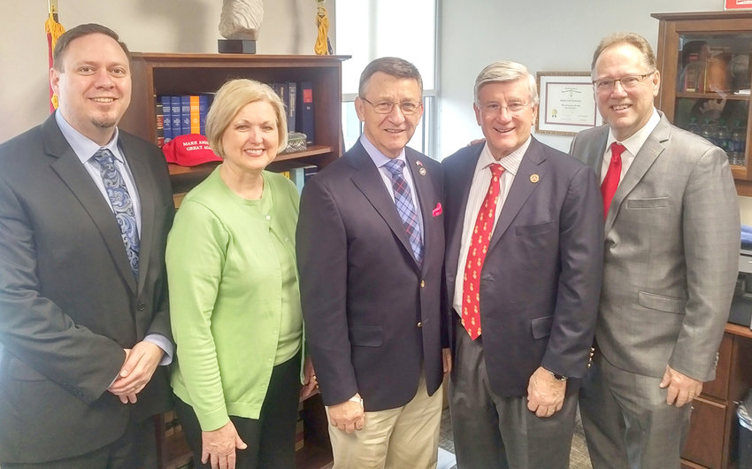 STATE REP. DAN HOWELL, center, was one of the members of Bradley County's legislative delegation who recently hosted a visit to Nashville by representatives from Life Bridges, a Cleveland-based organization that provides care for intellectually and developmentally disabled residents. From left are Jarrod Adams, Life Bridges CEO Diana Bridges, Howell, state Sen. Todd Gardenhire and Luke Queen.