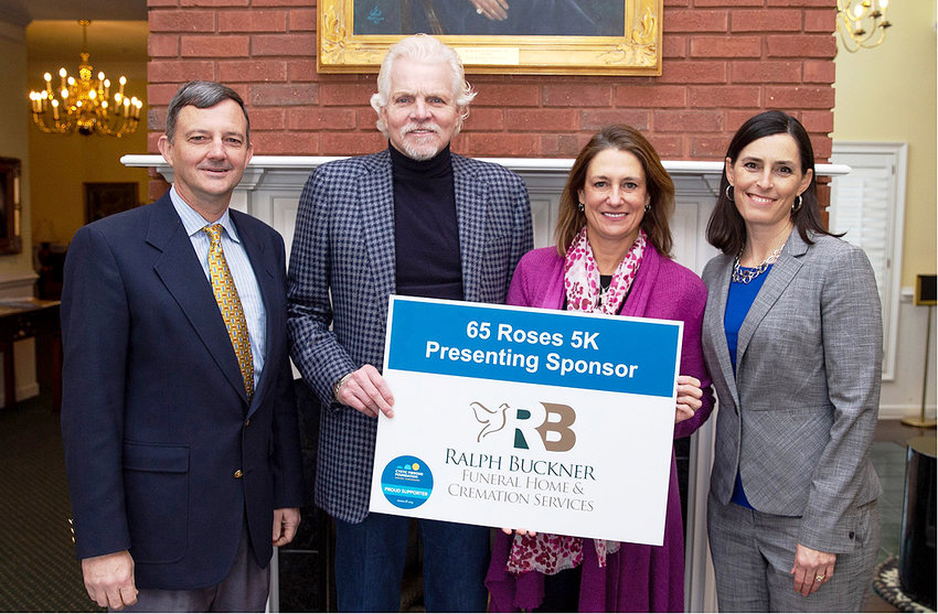 Dr. Bill Estes, title sponsors Ralph Buckner Jr. and his wife, Chari, and Vanessa Hammond, CF parent and Great Strides co-chair, are shown preparing for the Great Strides and 65 Roses 5K March 30.