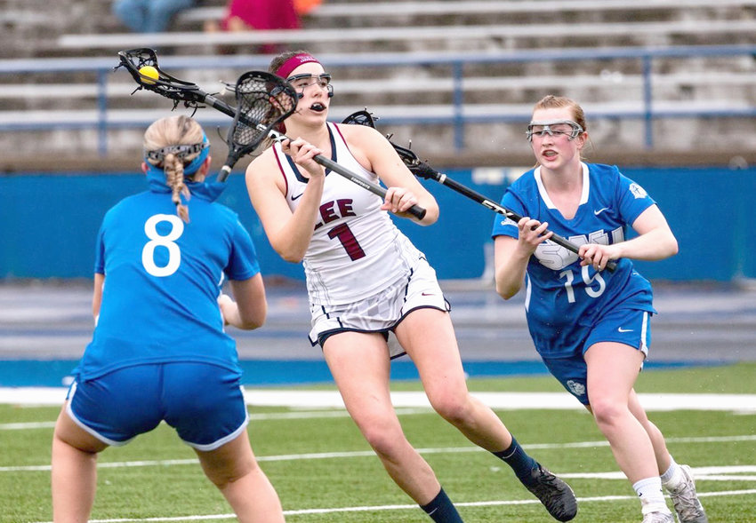 LEE UNIVERSITY freshman Shayna Ryan (1) tallied three goals and added an assist in the Lady Flames' 20-1 lacrosse win over Southern Wesleyan (S.C.) on the turf at Cleveland High School Saturday.