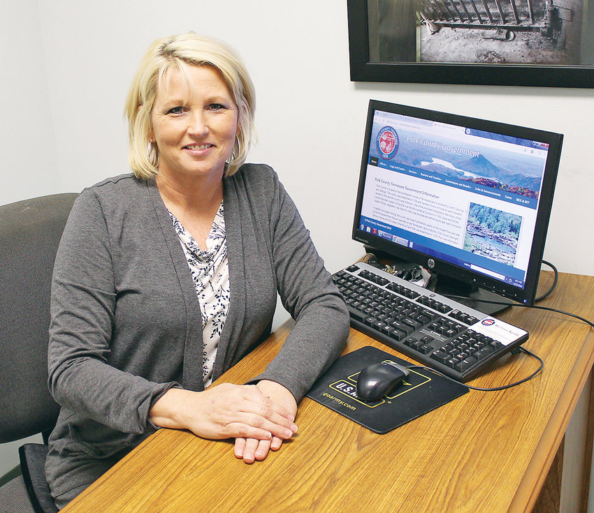 MELISSA KEITH, new Polk County Clerk of the Courts, is shown reviewing her Polk County government website. Keith is training new staffers, and planning some moderate upgrades, including a juror messaging system.