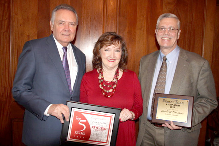 FOR THE THIRD year in a row, the real estate team of Jannis and Tim Sams has been named the top team in the Chattanooga region. The couple, at right, recently were recognized by Crye-Leike CEO and co-founder Harold Crye, far left.