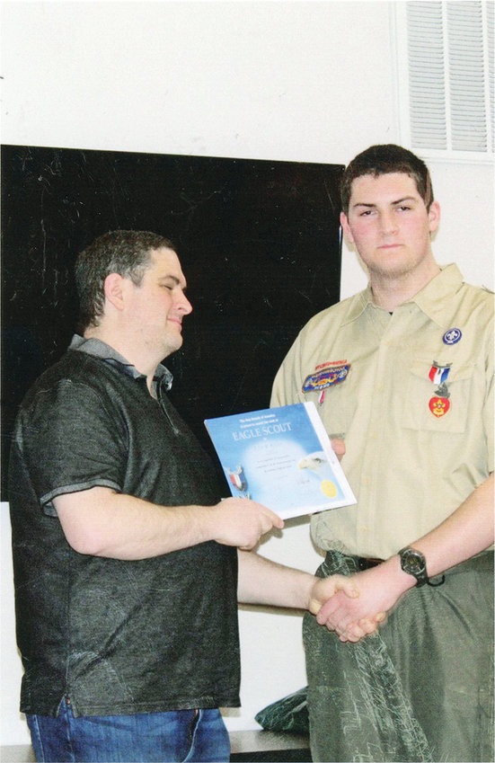TYLER KIBLER, a member of Boy Scout Troop 42 in Charles Town, W.Va., received his Eagle Scout certificate from his father, Jody Kibler, during a ceremony at city hall in Charles Town Feb. 23. Tyler is the son of Jody and Tara Kibler, former residents of Cleveland, and the grandson of Jimmy and Janet Kibler of Cleveland. For his Eagle Scout project, Tyler persuaded local merchants to donate materials to lay a brick walkway from the street to a covered memorial honoring Charles Town's veterans who lost their lives in war. Tyler, with the help of fellow Scouts and volunteers, completed the project over several days. Tyler's grandfather was also an Eagle Scout.