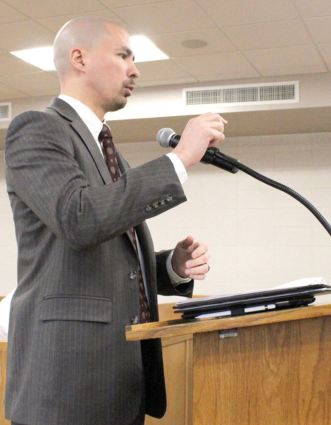 CHRIS BESSLER with Cumberland Securities speaks to the Bradley County Commission during Monday's voting session, regarding issuing bonds.