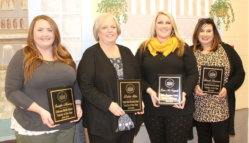 POLK COUNTY'S Teachers of the Year were announced Monday evening at the school board meeting at Copper Basin High School. This year's honorees include, from left, Jennifer Mowery of Chilhowee Middle School, Debbie Stiles of Copper Basin Elementary, Lara McTaggart of Benton Elementary, and Farrah Burrows of South Polk Elementary. Two others, Anita Pippin of Copper Basin High School, and Angie Ball of Polk County High School, were involved in school activities and unable to attend the meeting.
