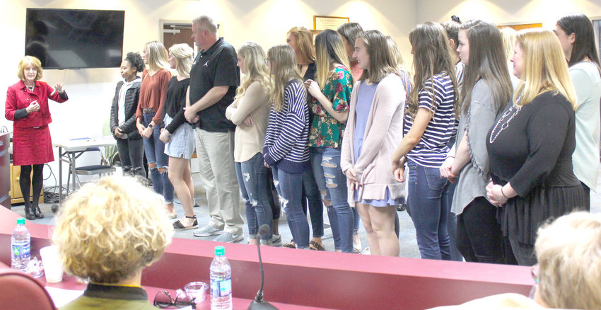 THE BEARETTES basketball team from Bradley Central High School was honored during Thursday's Bradley County Board of Education meeting. Here, Director of Schools Dr. Linda Cash, left, praises the girls for the hard work they put in in winning the TSSAA Class AAA State Championships.