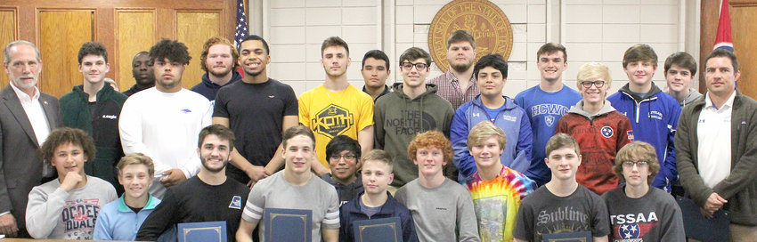 "THE CLEVELAND HIGH SCHOOL Blue Raiders Wrestling Team was honored with a proclamation earlier this week, with their victorious date of Feb. 16, 2019, declared as ""Cleveland Raiders Wrestling Day."" Flanking the team are County Mayor D. Gary Davis, left, and Coach Joey Knox, right)."