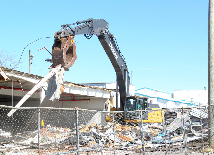 A HEAVY EQUIPMENT operator begins the demolition process at the rear section of the old Whirlpool Plant 2 facility earlier this week. The 100-plus-year-old factory building once housed the former Hardwick Stove Company, an appliance manufacturer that was purchased in 1982 by the Maytag Corporation. Maytag later acquired Magic Chef Company in 1986, and in March 2006, Maytag itself was purchased by the Whirlpool Corporation.