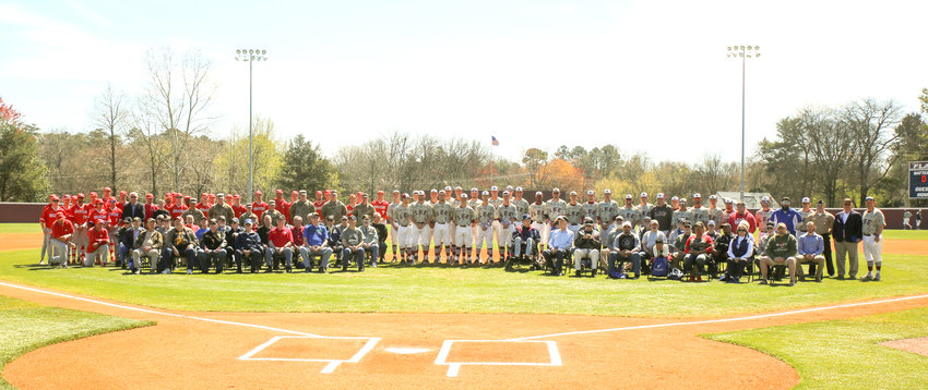 OVER 60 MILITARY VETERANS along with the Lee University baseball team and their visiting opponents from Memphis, Christian Brothers University, gathered for a group photo to conclude Saturday's ceremony.