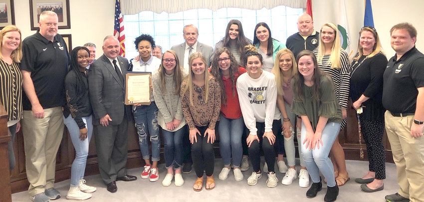 THE BRADLEY CENTRAL High School Bearettes pose with members of the Cleveland City Council on Monday. Cleveland Mayor Kevin Brooks read a proclamation honoring their championship season.