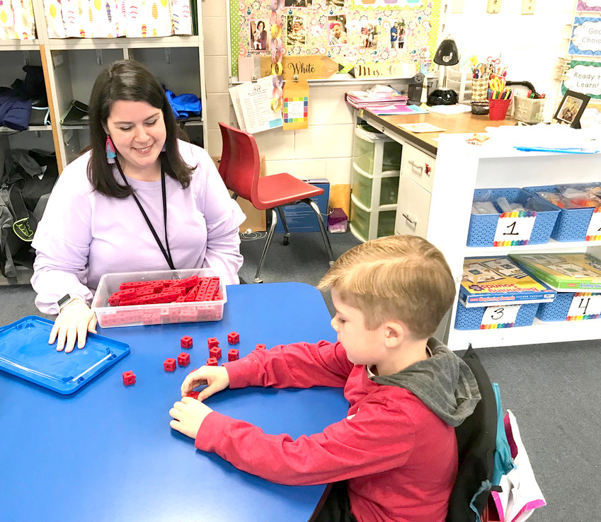 MOLLY JACKSON, a teacher at Donald P. Yates Primary School, helps student Landon Cissom with a kindergarten screening. Cleveland City Schools will be offering a chance to complete kindergarten screenings and other required steps during a massive kindergarten registration event this Friday and Saturday.