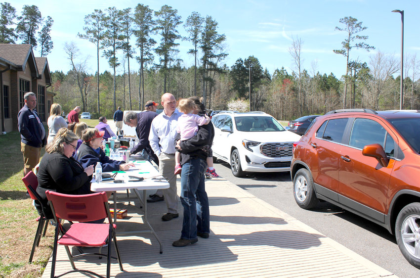 VOLUNTEERS work to register test drivers for the Don Ledford Automotive Drive For Students Drive-A-Thon, held at Park View Elementary School on Thursday.