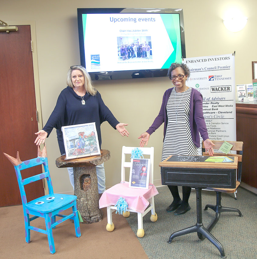 """Tickets are on sale now at the Cleveland/BradleyChamber of Commerce and the Red Ribbon for the 2019 Chair-ries Jubilee event, """"Coming of Age Transformation."""" Chairs and other items like these, presented here by Chair-ries members Kim Currin, left, and Traci Wright, will be available. Tickets are $25 in advance, $30 at the door. The doors will open at 6 p.m., Friday, April 12, at the Museum Center for bidding on these and many more items."""