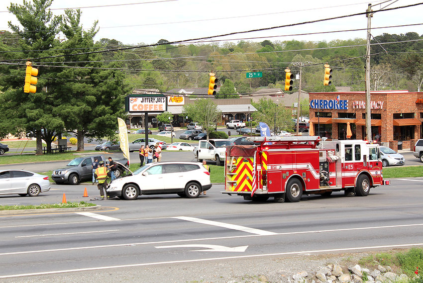 TRAFFIC ON 25TH STREET and surrounding streets was backed up Thursday afternoon as police, fire and EMS personnel worked to clear a collision at the intersection of 25th Street and Westside Drive. A white SUV and gray pickup truck were involved in the incident.