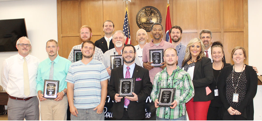 GRADUATES OF THE 10TH JUDICIAL DISTRICT Recovery Court's Drug Court program were honored during a ceremony last week. From left, front, are Richard Hughes, 10th Judicial District Public Defender; graduates Jeff May, Dakota Kincaid, Michael Miller and Cody Dawson; second row, Dustin Cox, Charlie Williams and Mario Whaley. Judge Andrew Freiberg is in very back. Other Drug Court team members in photo are Terry Wyatt, with the 10th Judicial District Drug Task Force; Sandon Bull with Parkridge Valley Outpatient Services of Cleveland; Amanda Kozak, case manager; Dallas Scott, assistant district attorney with the 10th Judicial District; Carol Myers, with Parkridge Valley Outpatient Services of Cleveland; and Kelly Peels, probation officer.