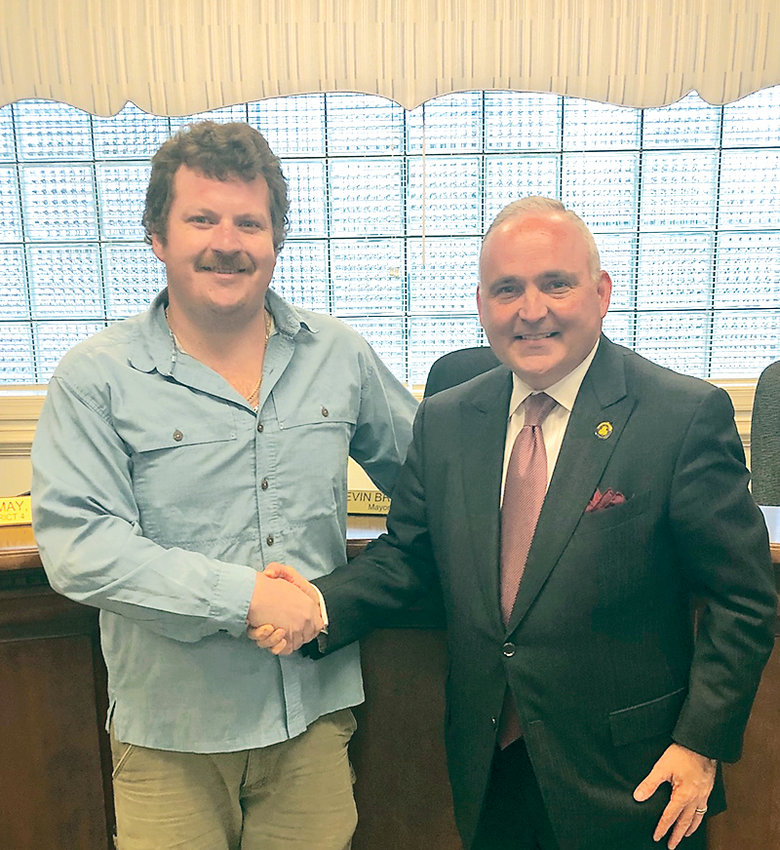 CODY KECK recently served as honorary Mayor for the Day for the city of Cleveland . Congratulating him is Cleveland Mayor Kevin Brooks, right.