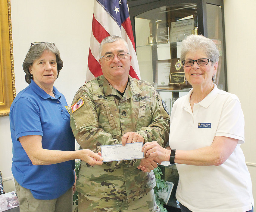 SGT. ROGER WRIGHT of the Bradley Central High School Junior ROTC, center, accepts a donation from the American Legion Auxiliary. Presenting the gift to Wright is Auxiliary President Janet Allen, right, and veteran and auxiliary member Mary Baier. Wright said the funds will be used for the Junior ROTC Color Guard. The Bradley Central Junior ROTC is 132 students strong.