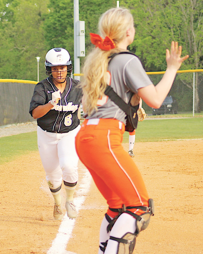 BRADLEY CENTRAL'S Makayla Goree races home on a hit by Haley Campbell against Meigs County, Wednesday at BCHS.