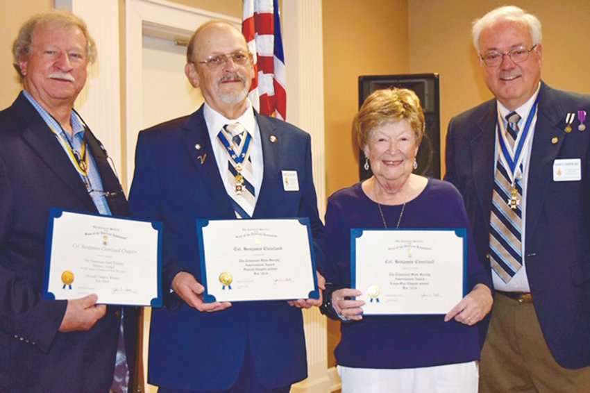 THE COL. BENJAMIN Cleveland Chapter received several awards during the Tennessee SAR state convention. From left, Chapter Registrar E. Lynn Freeman shows the certificate for most  new members last year; Jim McKinney shows with the overall Americanism Award; and Maggie Evans, widow of chapter founder Stan Evans, shows award for her late husband's work toward Americanism awards; and Chapter President Dr. David Chaffin.