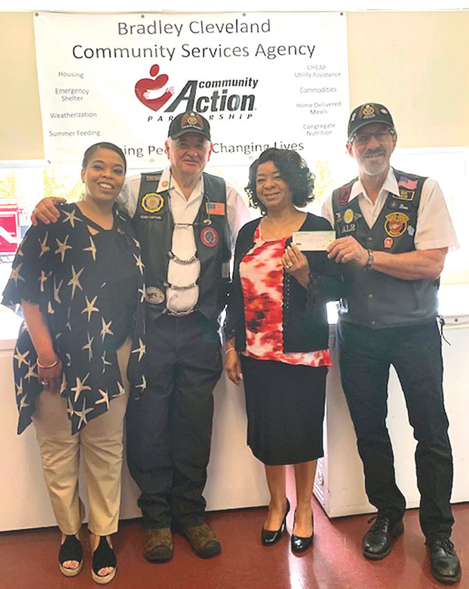 AMERICAN LEGION Riders Post 81 recently donated $200 to the Cleveland Emergency Shelter. From left are Naneka Walker, program manager;  Bob Taylor, assistant director of ALR 81; Royce Dale Enos, administrative assistant; and David Curler, director of ALR 81.